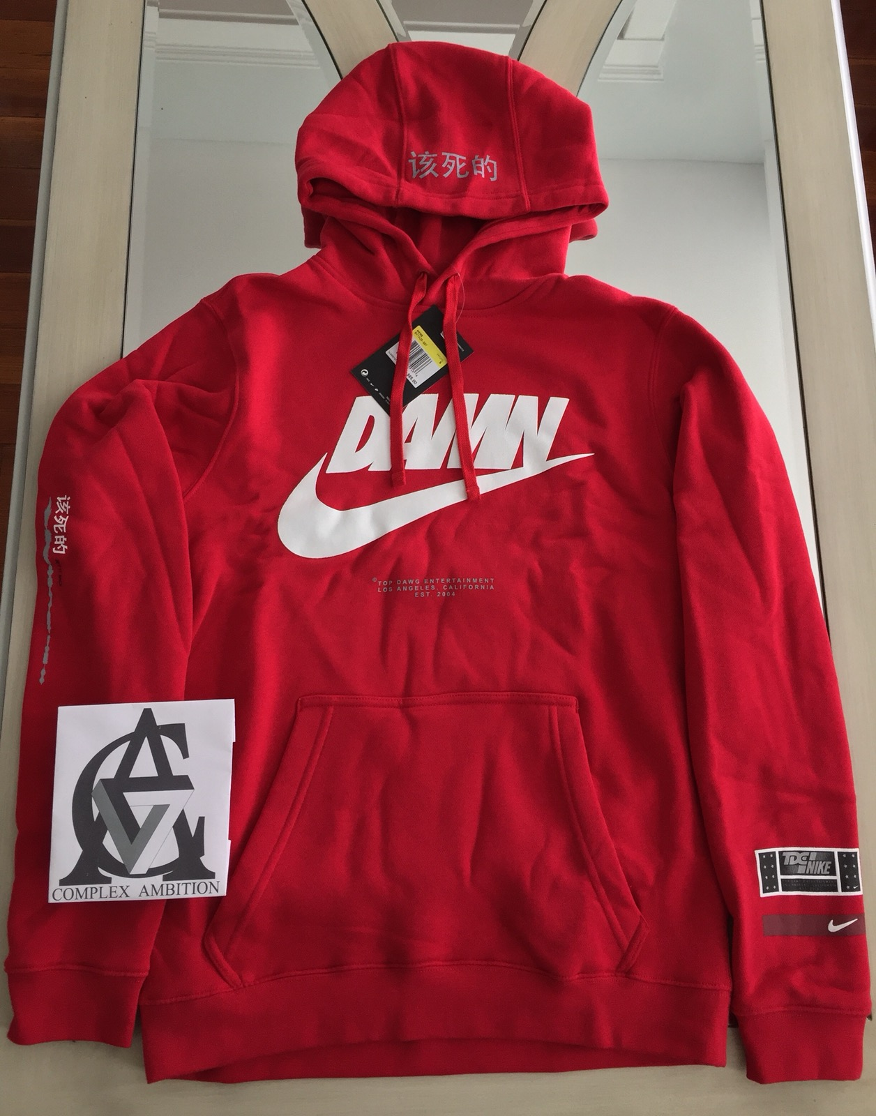 dfc74de6ee41a Nike × Kendrick Lamar ×. Nike Tde Red Damn Hoodie