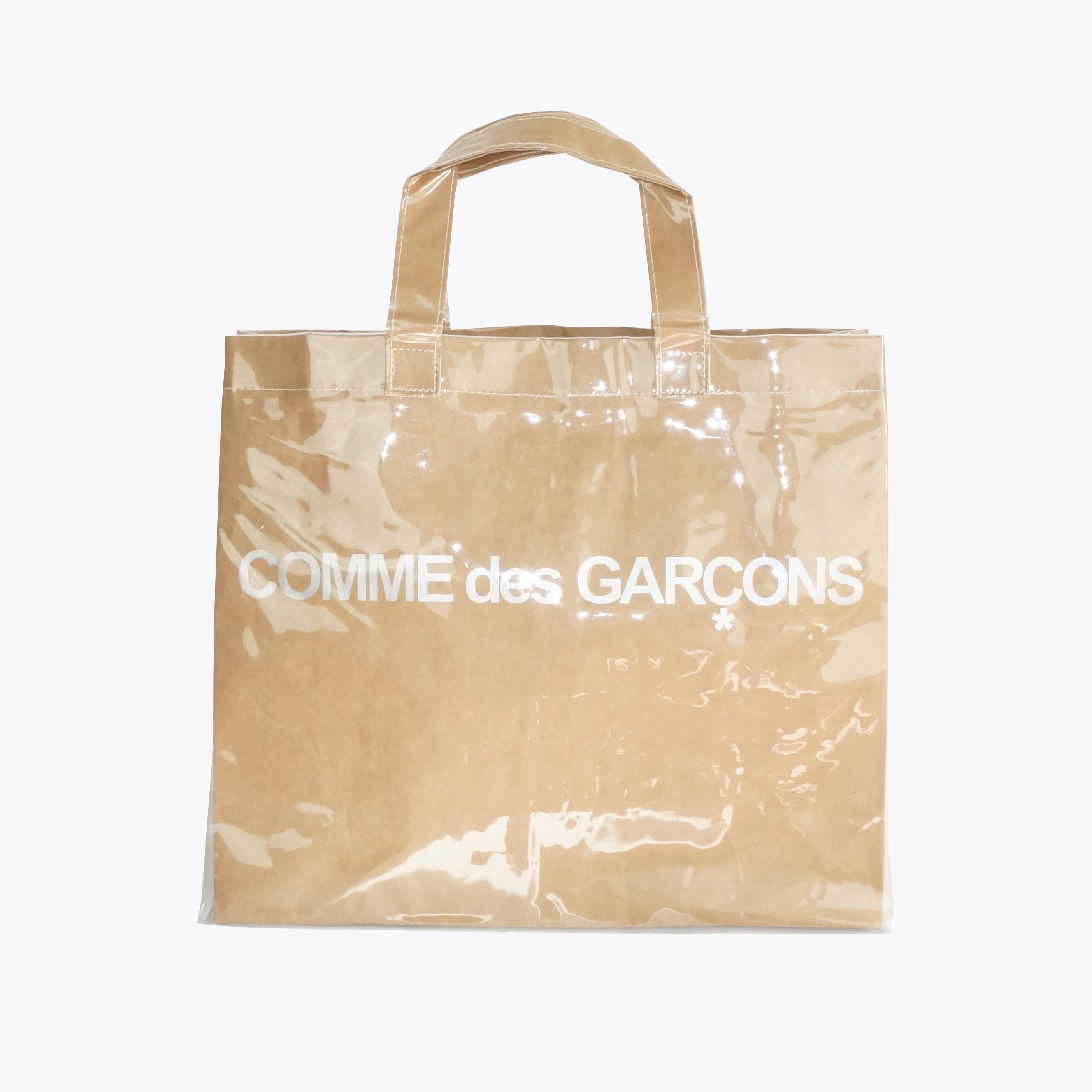 d03defa1a34277 Comme des Garcons ×. PVC Plastic Paper Tote Bag. Size: ONE SIZE