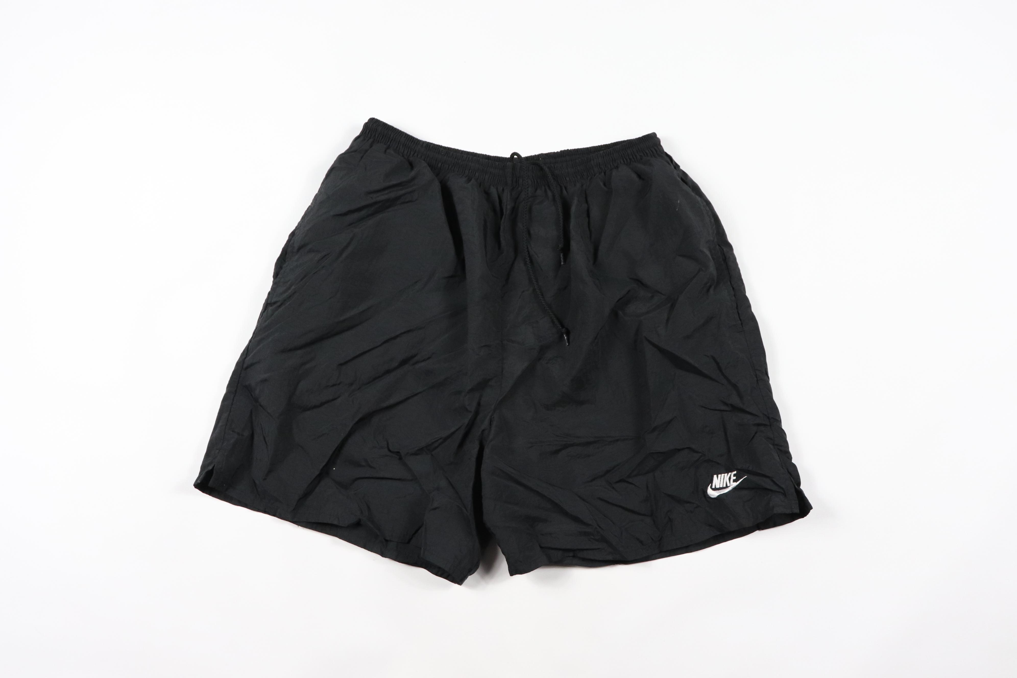 3928a575ee Nike × Vintage ×. Vintage 90s Nike Mens Large Spell Out Big Logo Nylon Swim  Trunks Shorts Black