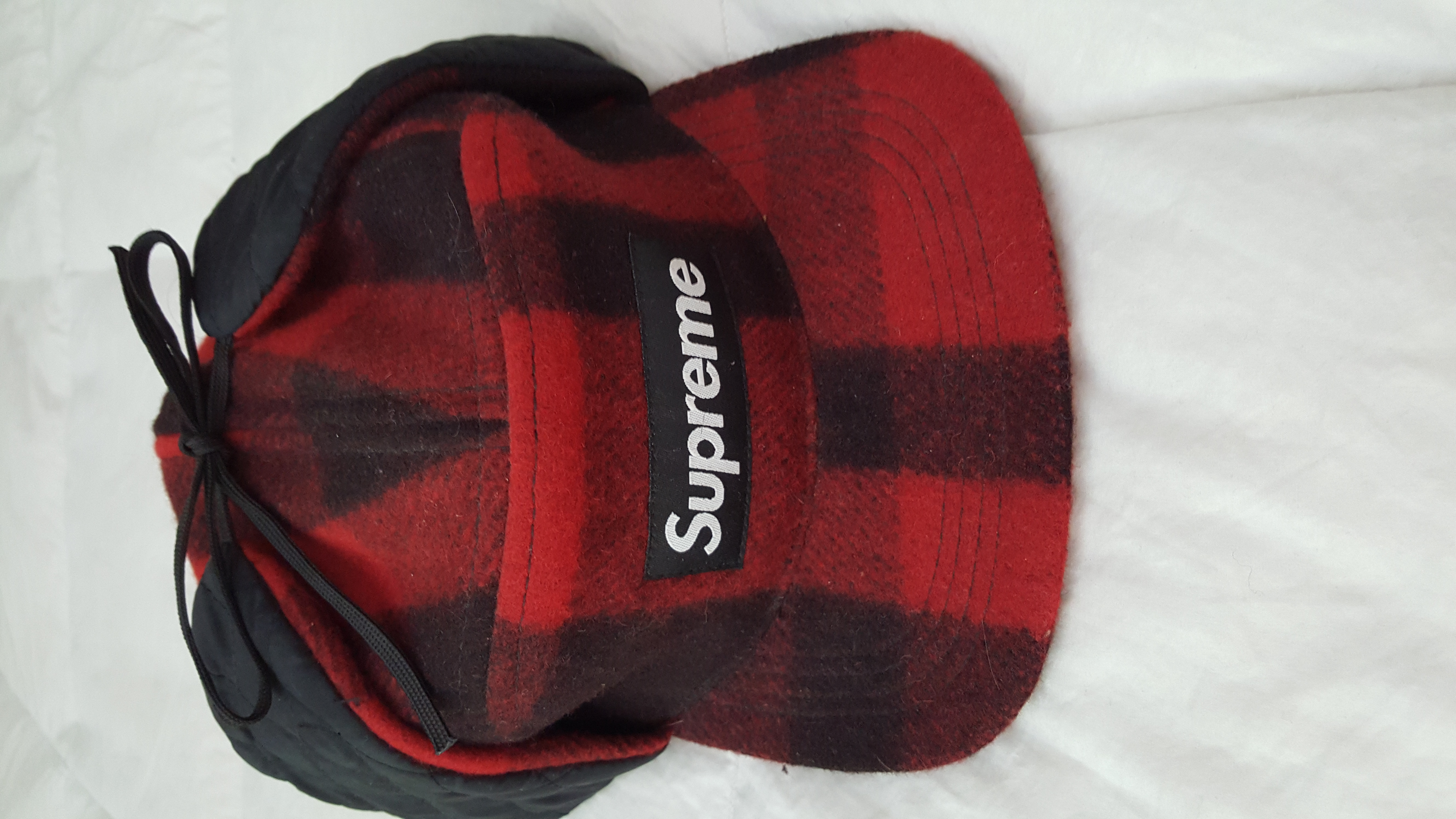 f003dc427c713 Supreme Supreme red and black lumberjack earflap Size one size - Hats for  Sale - Grailed