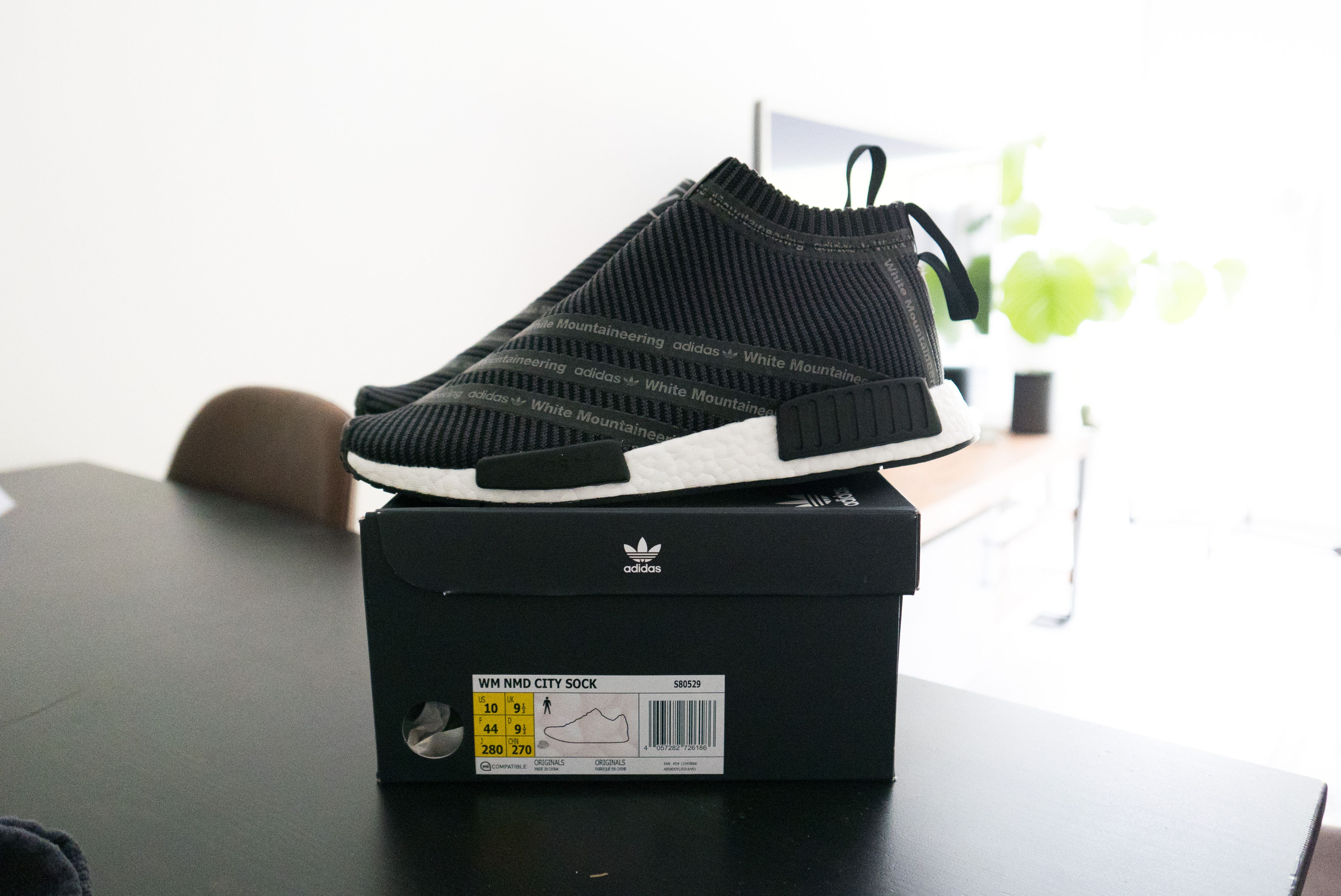62025656b Adidas × White Mountaineering. Adidas x White Mountaineering NMD CS1  Primeknit Black