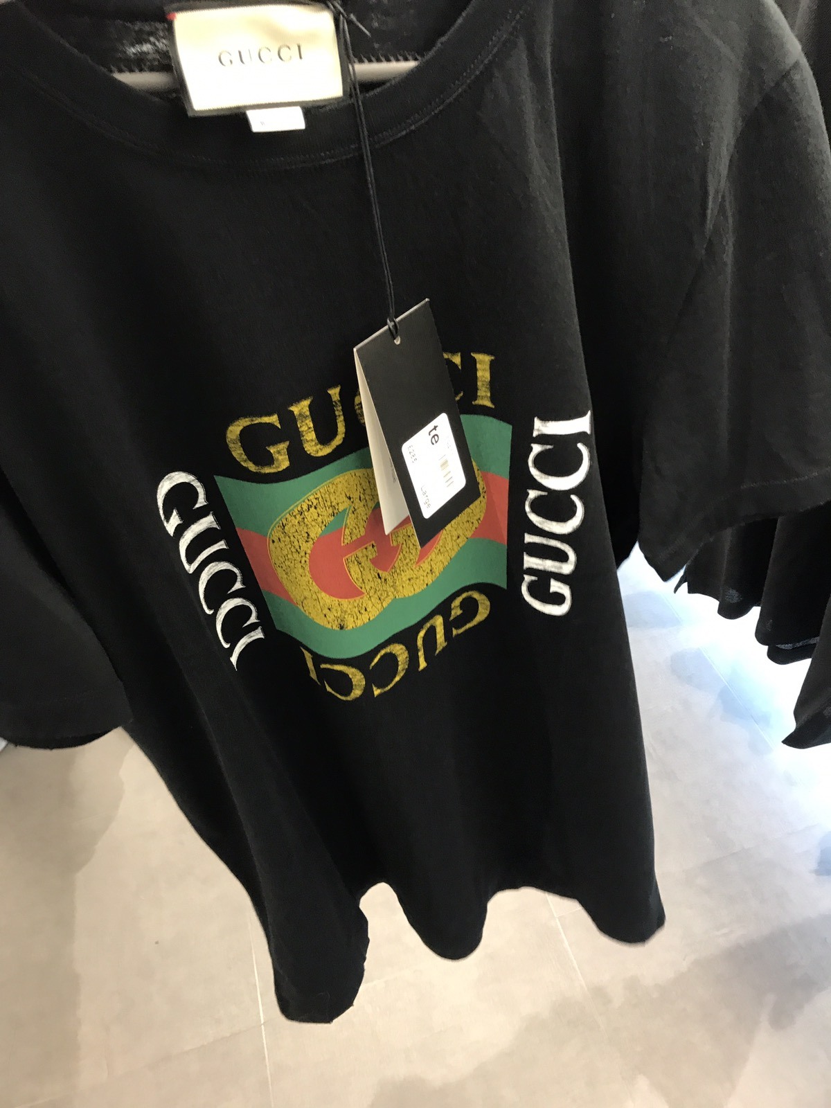 f24765737 Fake Black Gucci T Shirt - Nils Stucki Kieferorthopäde