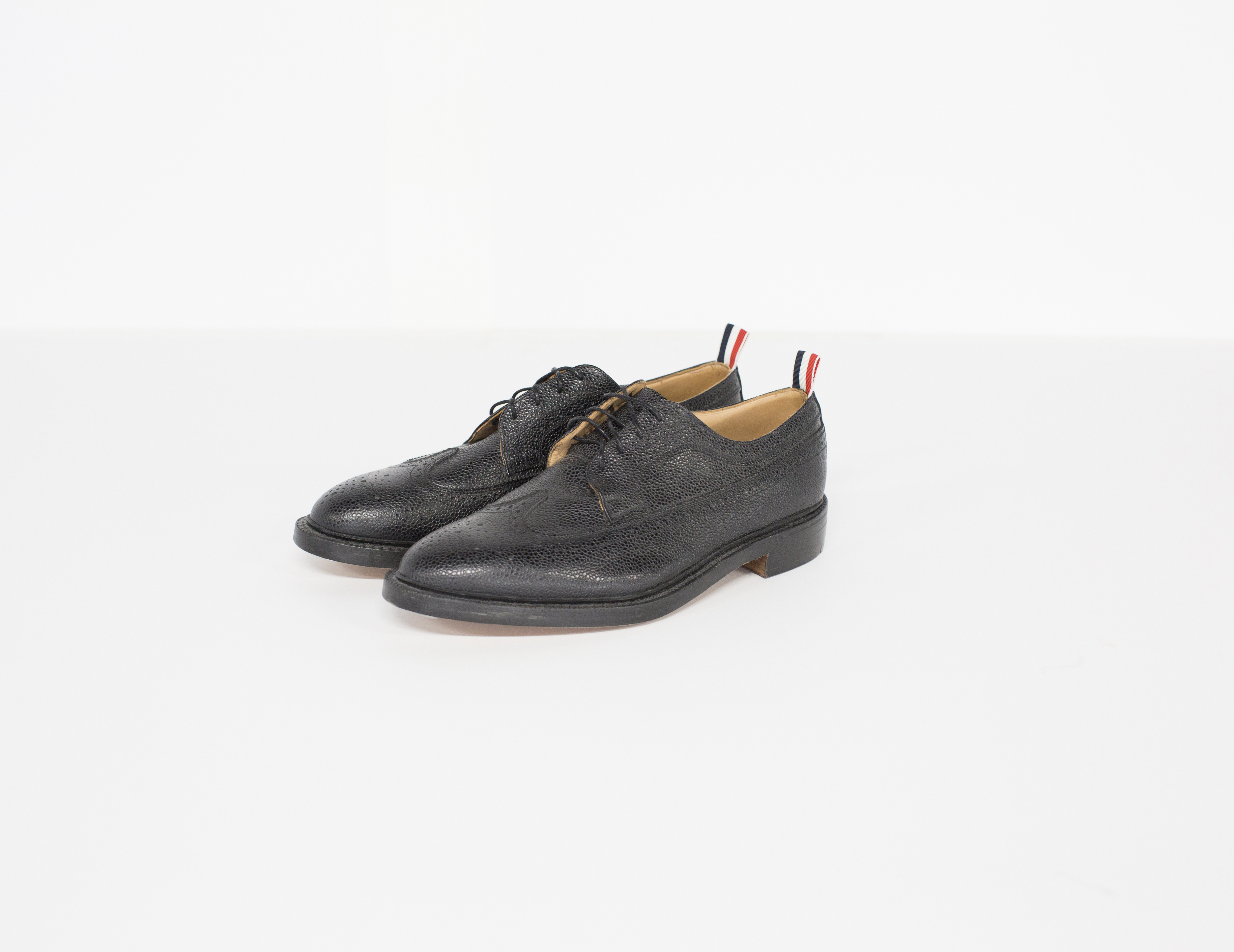 bad999c82cdada Thom Browne ×. Classic longwing brogue in black pebble grain leather.